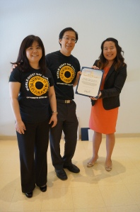 Doctors Linden and Limfat accept Congressional Certificate of Achievement from Viola Van of Congresswoman Judy Chu's office.