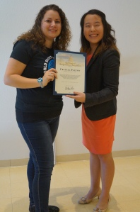 Crystal accepts her Congressional Certificate.